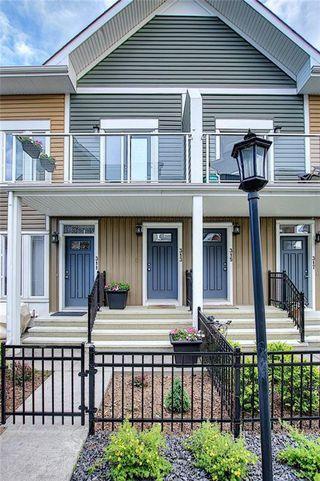 Photo 1: 313 AUBURN BAY Square SE in Calgary: Auburn Bay Row/Townhouse for sale : MLS®# C4302662