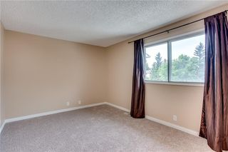 Photo 24: 113 WOODSMAN Lane SW in Calgary: Woodbine Row/Townhouse for sale : MLS®# C4259264