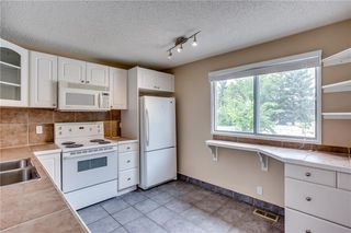 Photo 11: 113 WOODSMAN Lane SW in Calgary: Woodbine Row/Townhouse for sale : MLS®# C4259264