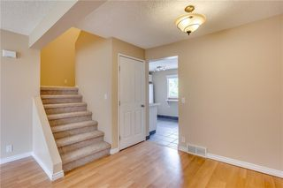 Photo 9: 113 WOODSMAN Lane SW in Calgary: Woodbine Row/Townhouse for sale : MLS®# C4259264
