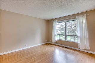 Photo 7: 113 WOODSMAN Lane SW in Calgary: Woodbine Row/Townhouse for sale : MLS®# C4259264