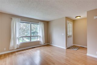 Photo 4: 113 WOODSMAN Lane SW in Calgary: Woodbine Row/Townhouse for sale : MLS®# C4259264