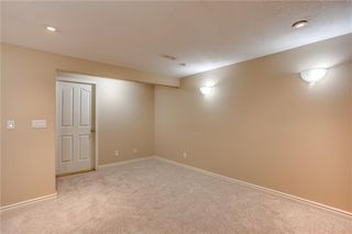 Photo 28: 113 WOODSMAN Lane SW in Calgary: Woodbine Row/Townhouse for sale : MLS®# C4259264
