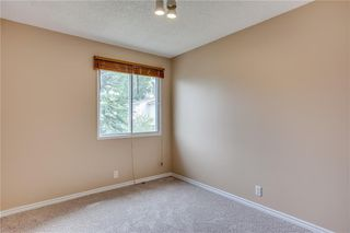 Photo 22: 113 WOODSMAN Lane SW in Calgary: Woodbine Row/Townhouse for sale : MLS®# C4259264