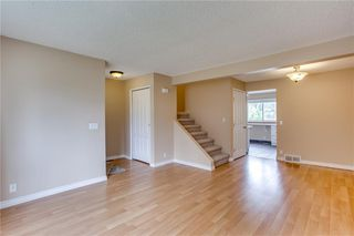 Photo 5: 113 WOODSMAN Lane SW in Calgary: Woodbine Row/Townhouse for sale : MLS®# C4259264