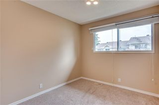 Photo 20: 113 WOODSMAN Lane SW in Calgary: Woodbine Row/Townhouse for sale : MLS®# C4259264