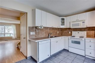 Photo 12: 113 WOODSMAN Lane SW in Calgary: Woodbine Row/Townhouse for sale : MLS®# C4259264