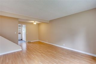 Photo 6: 113 WOODSMAN Lane SW in Calgary: Woodbine Row/Townhouse for sale : MLS®# C4259264