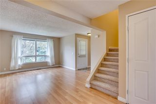 Photo 10: 113 WOODSMAN Lane SW in Calgary: Woodbine Row/Townhouse for sale : MLS®# C4259264