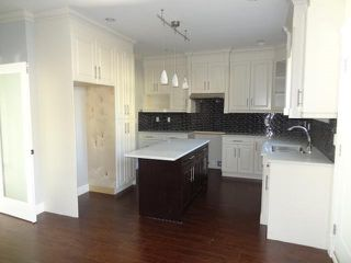 """Photo 5: 4812 DUMFRIES Street in Vancouver: Knight House for sale in """"KNIGHT"""" (Vancouver East)  : MLS®# R2422045"""