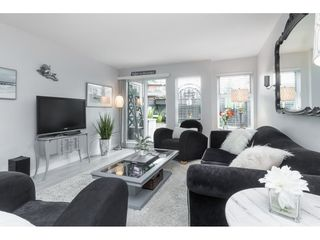 """Photo 1: 119 1850 E SOUTHMERE Crescent in Surrey: Sunnyside Park Surrey Condo for sale in """"SOUTHMERE PLACE"""" (South Surrey White Rock)  : MLS®# R2465271"""