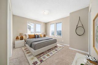 Photo 5: 47 AUBURN BAY Link SE in Calgary: Auburn Bay Row/Townhouse for sale : MLS®# A1010626