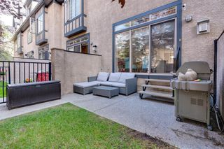 Photo 3: 16 6 SCARPE Drive SW in Calgary: Garrison Woods Row/Townhouse for sale : MLS®# A1023915