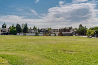 Photo 8: 16 6 SCARPE Drive SW in Calgary: Garrison Woods Row/Townhouse for sale : MLS®# A1023915