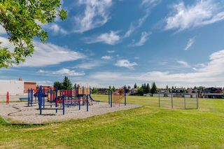Photo 7: 16 6 SCARPE Drive SW in Calgary: Garrison Woods Row/Townhouse for sale : MLS®# A1023915