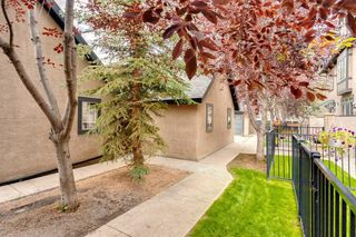 Photo 5: 16 6 SCARPE Drive SW in Calgary: Garrison Woods Row/Townhouse for sale : MLS®# A1023915