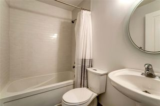 Photo 34: 16 6 SCARPE Drive SW in Calgary: Garrison Woods Row/Townhouse for sale : MLS®# A1023915