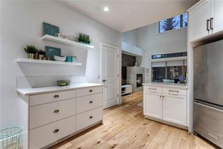 Photo 16: 16 6 SCARPE Drive SW in Calgary: Garrison Woods Row/Townhouse for sale : MLS®# A1023915