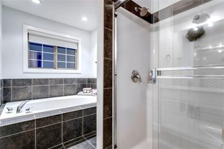 Photo 25: 16 6 SCARPE Drive SW in Calgary: Garrison Woods Row/Townhouse for sale : MLS®# A1023915