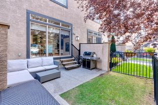 Photo 4: 16 6 SCARPE Drive SW in Calgary: Garrison Woods Row/Townhouse for sale : MLS®# A1023915