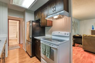 """Photo 12: 402 5340 HASTINGS Street in Burnaby: Capitol Hill BN Condo for sale in """"CEDARWOOD"""" (Burnaby North)  : MLS®# R2408807"""