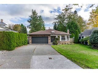 Photo 1: 13516 15A Avenue in Surrey: Crescent Bch Ocean Pk. House for sale (South Surrey White Rock)  : MLS®# R2515030