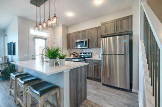 Photo 1: 8317 224 Street NW in Edmonton: Zone 58 House Half Duplex for sale : MLS®# E4194695