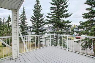 Photo 17: 10 15 ROCKY RIDGE Gate NW in Calgary: Rocky Ridge Row/Townhouse for sale : MLS®# A1028655