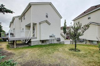 Photo 40: 10 15 ROCKY RIDGE Gate NW in Calgary: Rocky Ridge Row/Townhouse for sale : MLS®# A1028655