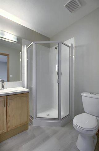 Photo 30: 10 15 ROCKY RIDGE Gate NW in Calgary: Rocky Ridge Row/Townhouse for sale : MLS®# A1028655
