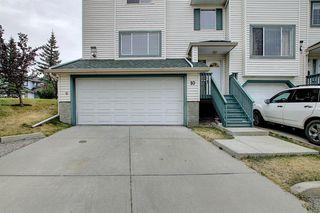 Photo 5: 10 15 ROCKY RIDGE Gate NW in Calgary: Rocky Ridge Row/Townhouse for sale : MLS®# A1028655