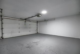 Photo 38: 10 15 ROCKY RIDGE Gate NW in Calgary: Rocky Ridge Row/Townhouse for sale : MLS®# A1028655