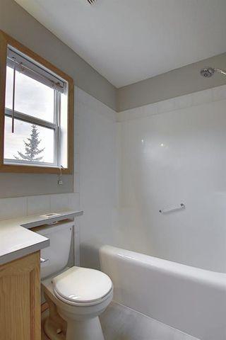 Photo 26: 10 15 ROCKY RIDGE Gate NW in Calgary: Rocky Ridge Row/Townhouse for sale : MLS®# A1028655