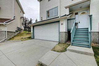 Photo 4: 10 15 ROCKY RIDGE Gate NW in Calgary: Rocky Ridge Row/Townhouse for sale : MLS®# A1028655