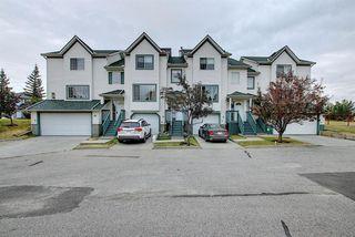 Photo 1: 10 15 ROCKY RIDGE Gate NW in Calgary: Rocky Ridge Row/Townhouse for sale : MLS®# A1028655