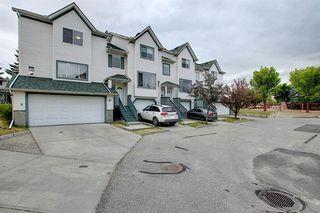 Photo 2: 10 15 ROCKY RIDGE Gate NW in Calgary: Rocky Ridge Row/Townhouse for sale : MLS®# A1028655