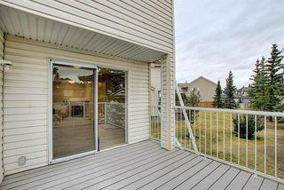 Photo 18: 10 15 ROCKY RIDGE Gate NW in Calgary: Rocky Ridge Row/Townhouse for sale : MLS®# A1028655
