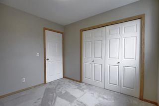 Photo 29: 10 15 ROCKY RIDGE Gate NW in Calgary: Rocky Ridge Row/Townhouse for sale : MLS®# A1028655