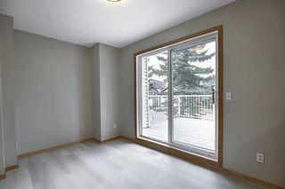 Photo 6: 10 15 ROCKY RIDGE Gate NW in Calgary: Rocky Ridge Row/Townhouse for sale : MLS®# A1028655