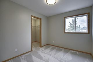 Photo 27: 10 15 ROCKY RIDGE Gate NW in Calgary: Rocky Ridge Row/Townhouse for sale : MLS®# A1028655