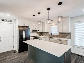 Photo 13: 171 Woodstock Place SW in Calgary: Woodlands Detached for sale : MLS®# A1047853