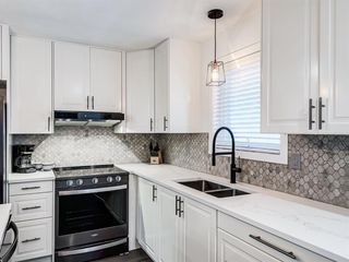 Photo 19: 171 Woodstock Place SW in Calgary: Woodlands Detached for sale : MLS®# A1047853