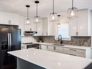 Photo 14: 171 Woodstock Place SW in Calgary: Woodlands Detached for sale : MLS®# A1047853