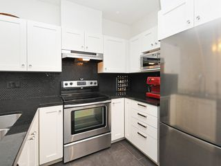 "Photo 13: 406 4550 FRASER Street in Vancouver: Fraser VE Condo for sale in ""Century"" (Vancouver East)  : MLS®# R2394359"