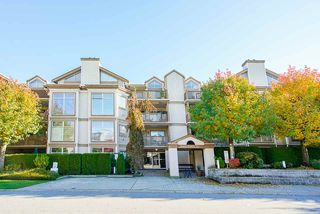 """Photo 1: 304 19131 FORD Road in Pitt Meadows: Central Meadows Condo for sale in """"WOODFORD MANOR"""" : MLS®# R2514716"""