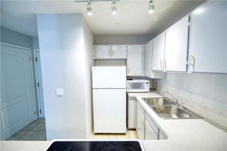 Photo 2: 215 2204 1 Street SW in Calgary: Mission Apartment for sale : MLS®# A1057983