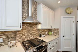 Photo 14: 2139 VIMY Way SW in Calgary: Garrison Woods Detached for sale : MLS®# C4289038