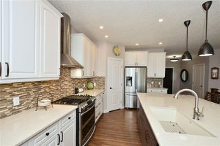 Photo 13: 2139 VIMY Way SW in Calgary: Garrison Woods Detached for sale : MLS®# C4289038