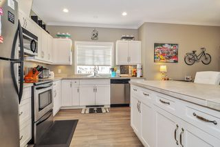 Photo 10: 101 20281 53A Avenue in Langley: Langley City Condo for sale : MLS®# R2444359