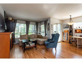 "Photo 1: 201 8717 160 Street in Surrey: Fleetwood Tynehead Condo for sale in ""Vernazza"" : MLS®# R2495689"